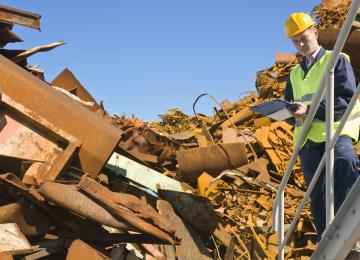 What do metal scrap yards do with the metal?